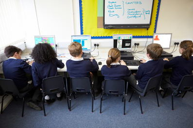 Line Of Children In School Computer Class